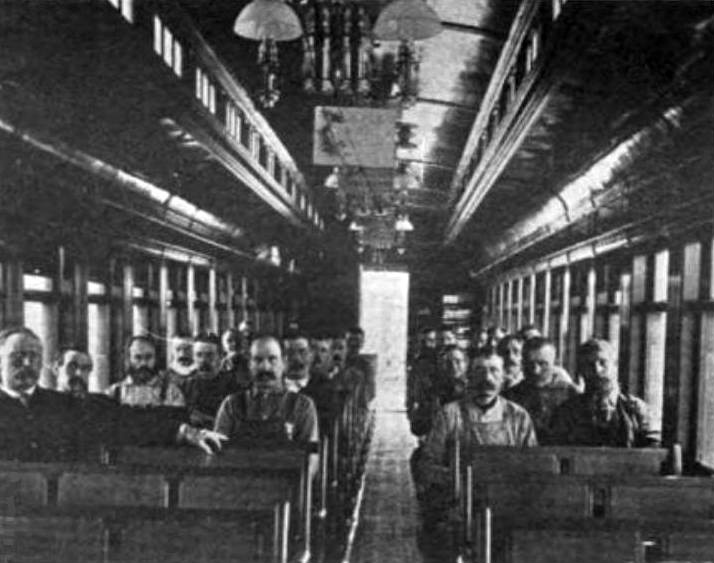 Railroad_workers_inside_the_railroad_chapel_car_Glad_Tidings