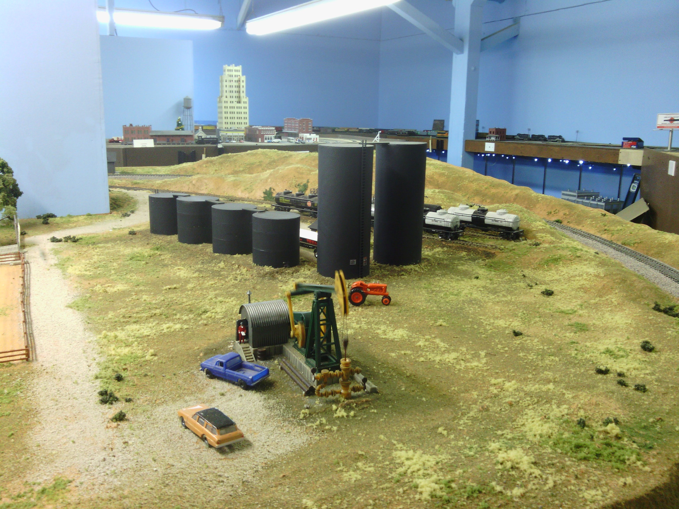 Model trains sharing a sip with dusty garison for 1 64 farm layouts