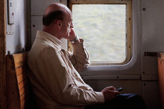 passenger-train-bald-man-thoughtfully-looking-out-window-moving-journey-rail-loneliness
